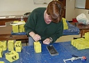 Sarah Holland prepares bricks for placement on the seabed.
