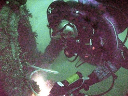 Diver using a Cygnus Instruments ultrasonic thickness gauge.
