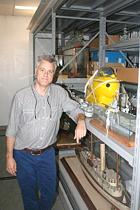Chief Curator Craig Bruns in the museum's storeroom.